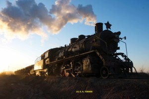 One of Fuxin's fleet of SY 2-8-2s at sunset, backing to the tip.